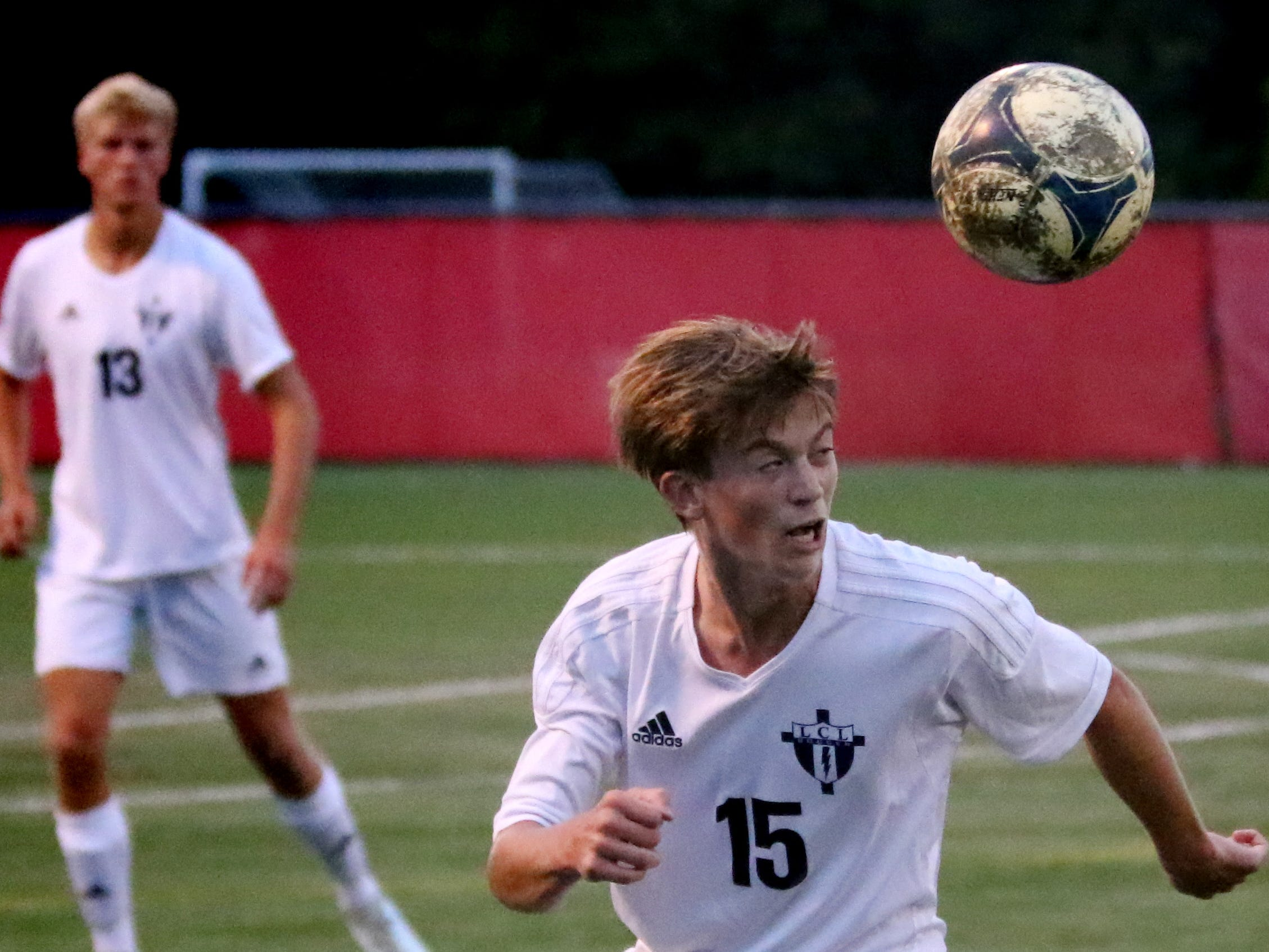 Lake Country Lutheran's Garrett Lueth heads the ball against Nicolet at Uihlein Soccer Park on Aug. 21.
