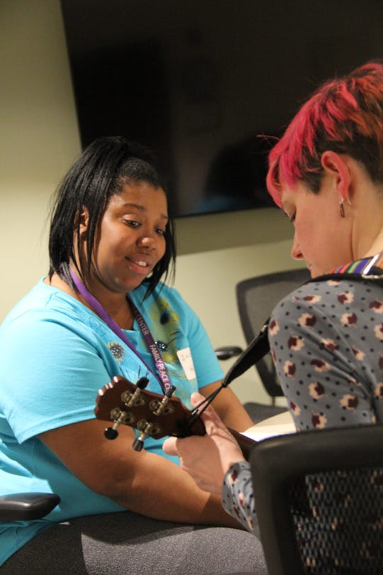 Zakkiyya Johnson (left) and Meaghan Heinrich work on a song during a Lullaby Project creation session.