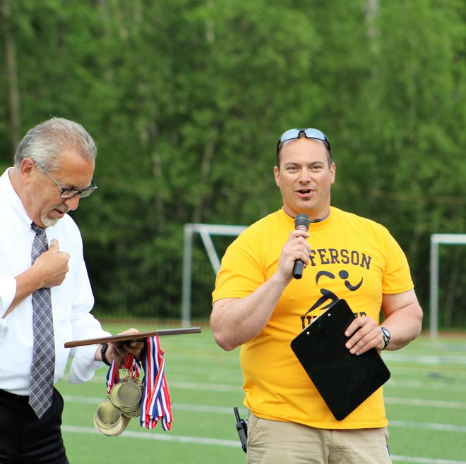 Brian Silipena (right) will become the new Pequannock athletic director in October. He and former Jefferson AD John DiColo distribute medals after the inaugural NJAC Unified track and field meet.