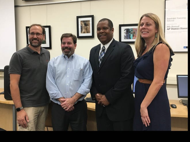 Randolph introduced new athletic director David Hutchinson (third from left) at its Board of Education meeting on Tuesday night. He is pictured with Board president Ronald Conti, vice president Joe Faranetta, and superintendent Jennifer Fano.