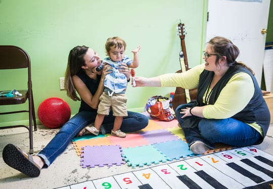 "Kameron Kadinger, 1, attends a therapy session at Hillcroft Services with his mother, Amanda Jordan. Kameron has one of six documented cases of ""biallelic HMBS deficiency,"" caused by combined mutations within the same gene that causes acute intermittent porphyria. It took sequencing of Kameron's genes for doctors to finally determine a diagnosis."
