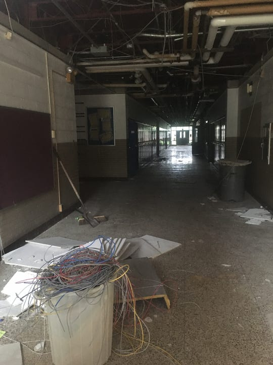 A contractor is salvaging material from Storer Elementary School prior to demolition.