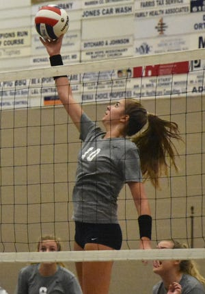 Blackman's Ashllyn King gets a kill during a recent match. King had 12 kills, five aces and five blocks in a 3-1 win over Stewarts Creek Thursday.