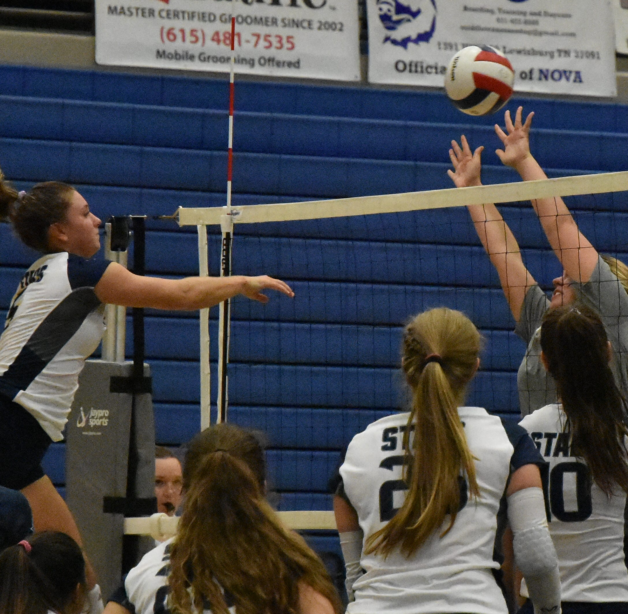 Siegel's Julia Wheeler (5) goes up for a kill Tuesday against  Blackman.