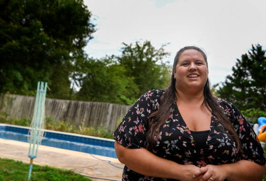 Laura Sivadoat talks about the foreclosure home with a pool that she and her husband bought during the recession, in Antioch, Tenn., Tuesday, Aug. 21, 2018.