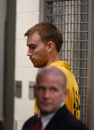 Waffle House shooting suspect Travis Reinking walks back to jail after the hearing on his mental health in criminal court Aug. 22. Mental health officials have since deemed Reinking competent to face his charges in court.