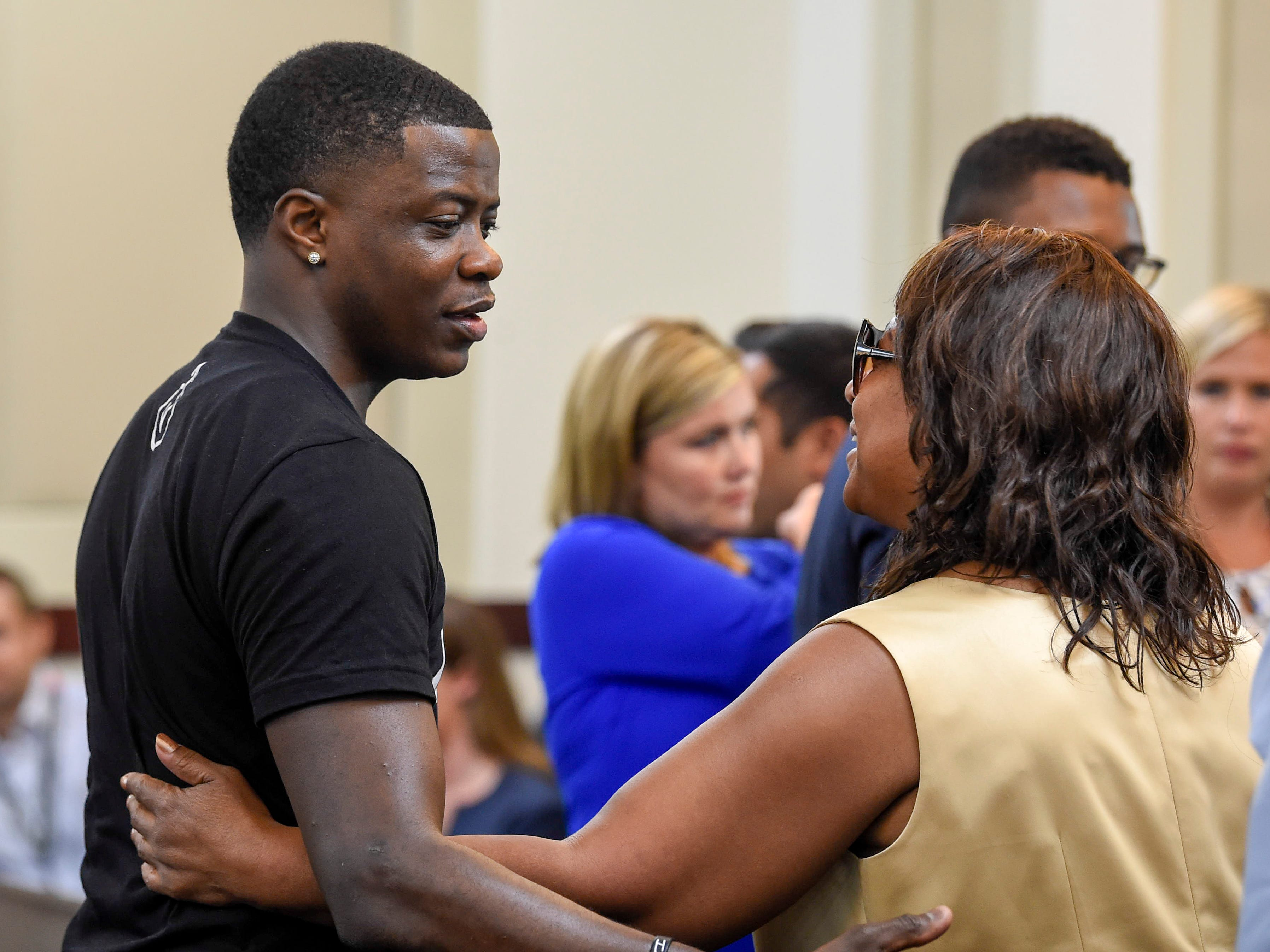 James Shaw Jr. greets Waffle House shooting victims' family members during the hearing on the mental health of Travis Reinking in criminal court Wednesday, Aug. 22, 2018, in Nashville, Tenn.
