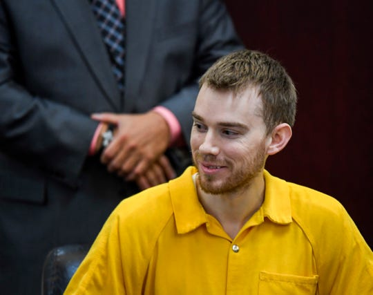 Travis Reinking laughs during his mental health hearing in criminal court Wednesday, Aug. 22, 2018, in Nashville, Tenn. Reinking is suspected of killing four people in a mass shooting in April at a Nashville Waffle House.