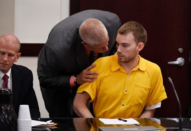 A court office stops Waffle House shooting suspect Travis Reinking from talking during the hearing on his mental health in criminal court Wednesday, Aug. 22, 2018, in Nashville, Tenn. Reinking is suspected of killing four people in a mass shooting in April at a Nashville Waffle House.