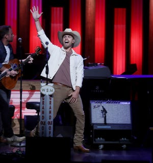 Dustin Lynch performs at the Grand Ole Opry Tuesday August 21, 2018.