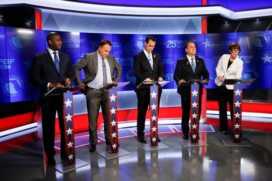 Democratic gubernatorial candidates, from left, Andrew Gillum, Jeff Greene, Chris King, Philip Levine and Gwen Graham await the start of a debate ahead of the Democratic primary for governor on Thursday, Aug. 2, 2018, in Palm Beach Gardens, Fla.