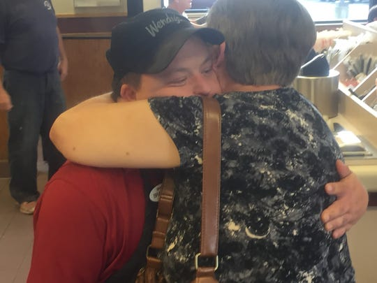 Brad gets a hug from Jackie Perry, who worked with him early in his Wendy's career.