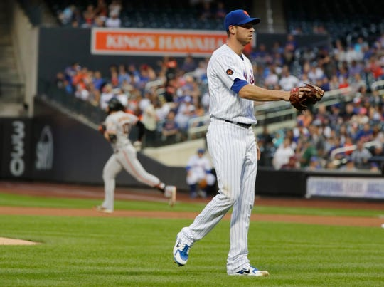 New York Mets starting pitcher Steven Matz reacts as San Francisco Giants' Evan Longoria runs the bases after hitting a two-run home run during the first inning of a baseball game Tuesday, Aug. 21, 2018, in New York.