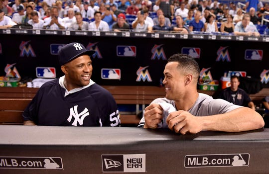 Aug 21, 2018; Miami, FL, USA; New York Yankees starting pitcher CC Sabathia (left) talks with Yankees right fielder Giancarlo Stanton (right) during the second inning against the Miami Marlins at Marlins Park.