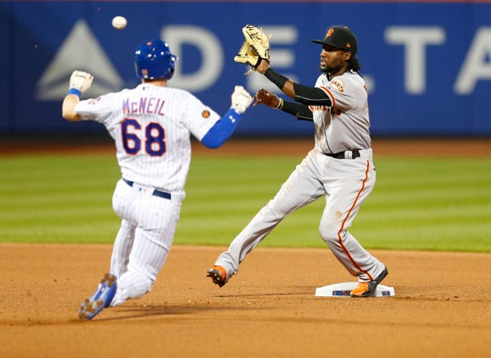 New York Mets second baseman Jeff McNeil (68) is caught attempting to steal second base by San Francisco Giants Alen Hanson (19)  in the fourth inning at Citi Field.