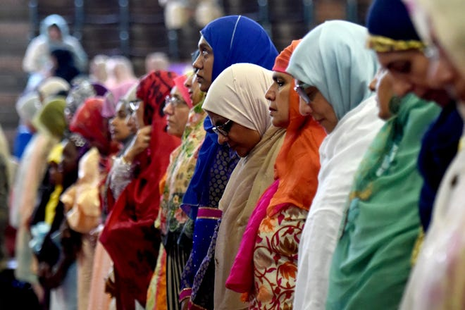 """Thousands of Muslims gather for prayer for Eid al-Adha, also called the """"Festival of Sacrifice,"""" one of the holiest holidays in their faith, at the Teaneck Armory on Wednesday, August 22, 2018."""