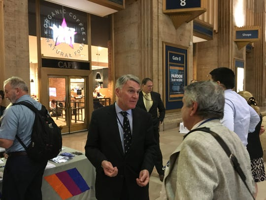NJ Transit Executive Director Kevin Corbett speaks to a rider about the Atlantic City Line closure at Philadelphia's 30th Street Station on Tuesday, Aug. 21, 2018.