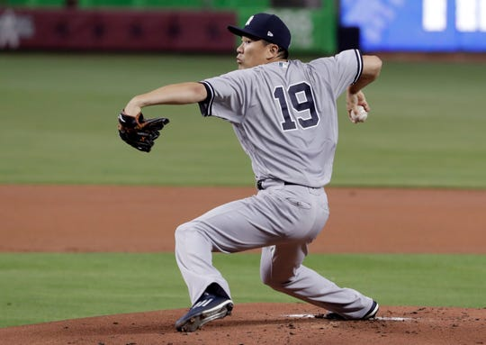 New York Yankees starting pitcher Masahiro Tanaka (19), of Japan, delivers during the first inning of a baseball game against the Miami Marlins, Tuesday, Aug. 21, 2018, in Miami.