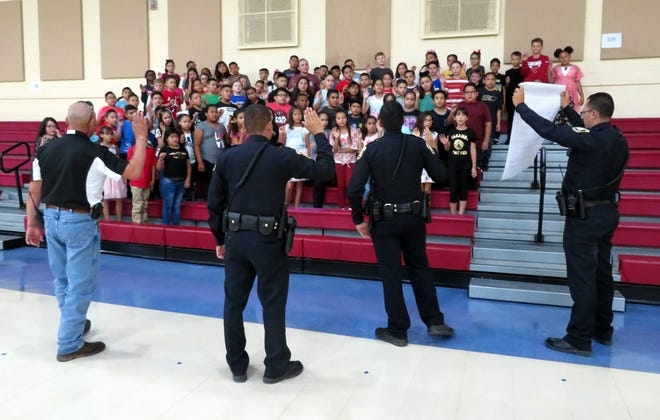 Bataan Elementary School fifth graders began there 2018-19 school year byhappening upon a mock crime scene in the hallwayleading to each of thefour fifth-grade classrooms. The students were sworn in as NCIS (New Crackerjack Investigative Sleuths) agents. Mayor Benny Jasso spoke words of wisdom and encouragement in his speech to the students. The students then repeated the NCIS oath which was read by one of Deming's finest. The officers and Mayor Jasso then pinned a badge on each of the students. The fifth-grade teachers who participated in this fun event were:Gina Simms, Melissa Noriega, Doris Lancasterand Kim Perea.