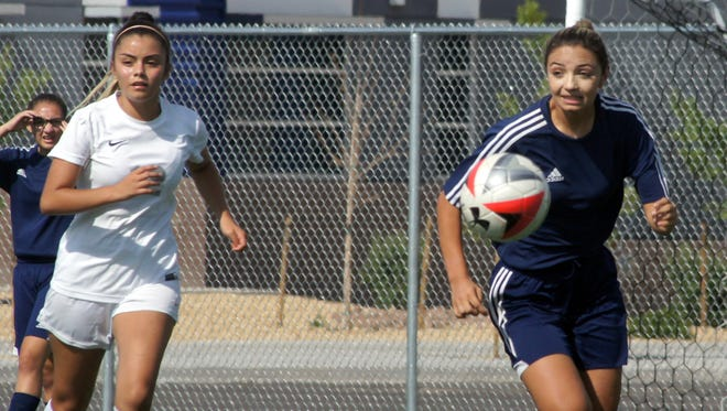 Junior Lady 'Cat Julissa Chavez (right) scored Deming's first goal of the season in the first half of a 2-0 shutout victory over the visiting Chaparral High Lobos on Tuesday at the new Deming High Soccer Field.