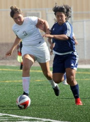 Play was physical throughout Tuesday's home opener against the Chaparral Lobos. Deming High girls were up to the task in registering a 2-0 victory at the new DHS Soccer Field.