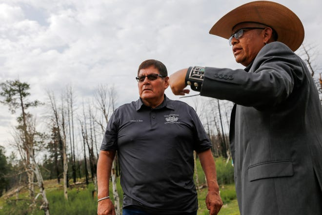 Navajo Nation Speaker LoRenzo Bates, left, talks with Navajo Nation Council Delegate Steven Begay Tuesday on Ch'ooshgai Mountain in the Naschitti Chapter.