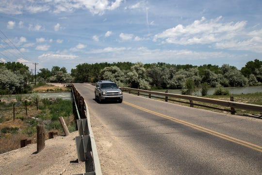 A vehicle crosses over the San Juan River June 11, 2017 on County Road 5500 southwest of Bloomfield.