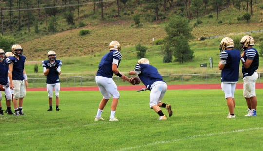 Warrior's practice passing, after the snap is complete, with precision and accuracy.