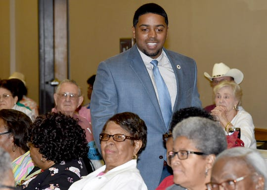 Rep. Dustin Miller visits the Opelousas Elderly Awareness seminar held Wednesday at the Opelousas Civic Center.