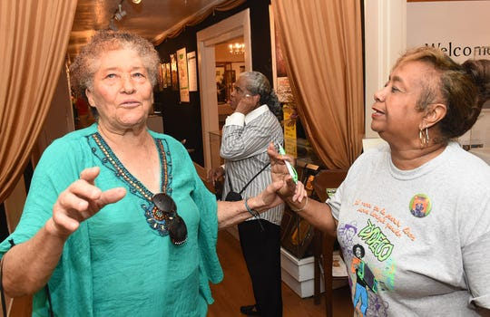 Eva Iford, left, and Lena Charles talk about zydeco while attending the pre-party held recently at the Opelousas Museum and Interpretive Center. The Southwest Louisiana Zydeco Festival is being held on Saturday, Aug. 31, at the Yambilee Building in Opelousas.