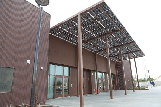 Solar panels provide energy and shade at the entrance to the new Richard Oliphant Elementary School in Indio, August 21, 2018.