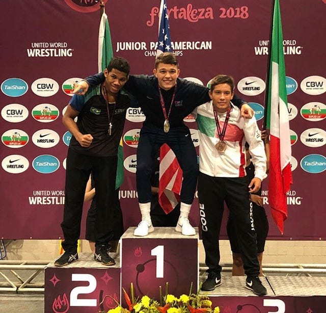 Anthony Mantanona, a Palm Desert grad, stands atop the podium after taking home the gold for Team USA at the Junior Pan-American Championships for wrestling Sunday.