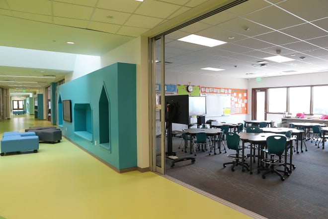 Some classrooms at Richard Oliphant Elementary School have sliding glass walls that open up into the hallway to allow collaboration between classes, August 21, 2018.