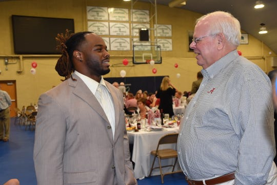 Trent Richardson and famed Alabama broadcaster Eli Gold visit prior to the Pensacola Bama Club Scholarship Kickoff event Tuesday at PSC's Hartsell Arena.