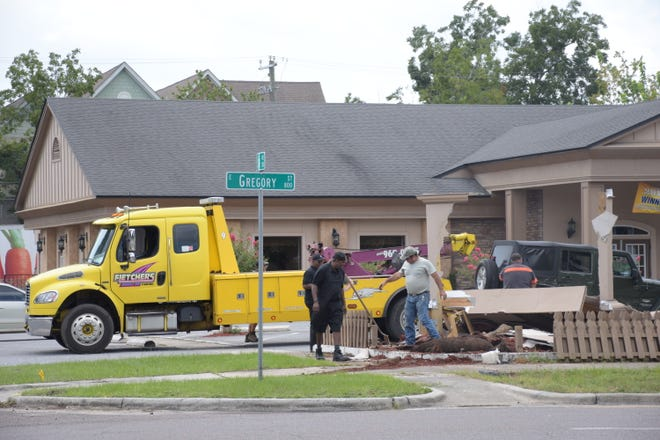 Two cars crashed into a sign outside Another Broken Egg on East Gregory Street in Pensacola on Wednesday, Aug. 22, 2018.