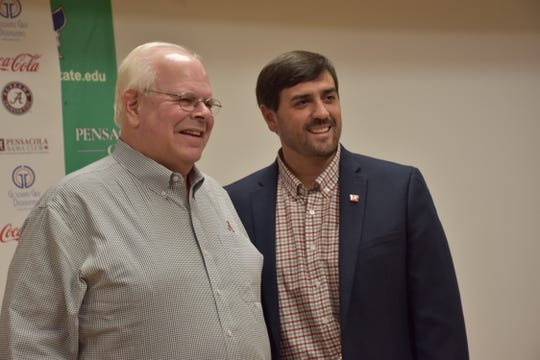 Will Moore, right, president of the Pensacola Bama Club, joins with famed Alabama broadcaster Eli Gold prior to Tuesday's kickoff event at Pensacola State College
