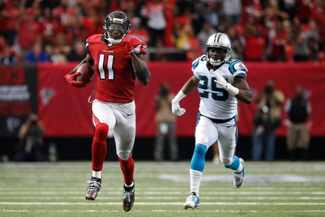 Atlanta Falcons wide receiver Julio Jones (11) runs for a touchdown against Carolina Panthers cornerback Bene Benwikere (25) in the fourth quarter of their game at the Georgia Dome in 2016. The Falcons won 48-33.