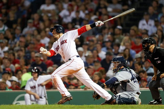 Boston Red Sox right fielder J.D. Martinez (28) hits a solo home run during the third inning against the Tampa Bay Rays at Fenway Park.
