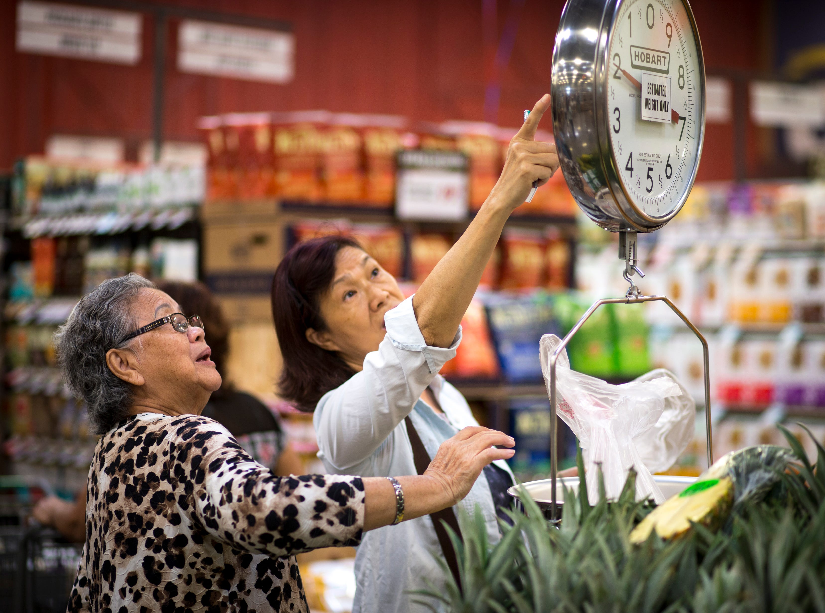Sylvia Ma (right) and Kim Phan weigh produce Aug. 22, 2018, at the Sprouts Farmer's Market at Seventh Avenue and Osborn Road in Phoenix.
