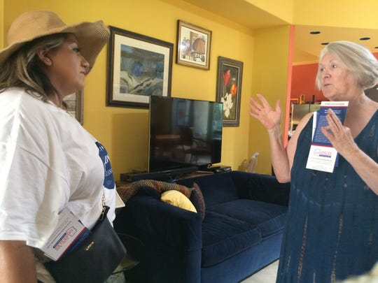 Alma Hernandez (left) speaks with voter Shirley McGhee inside her Tucson home. Hernandez, a first time candidate for the Arizona Legislature, was canvassing on July 29, 2018.
