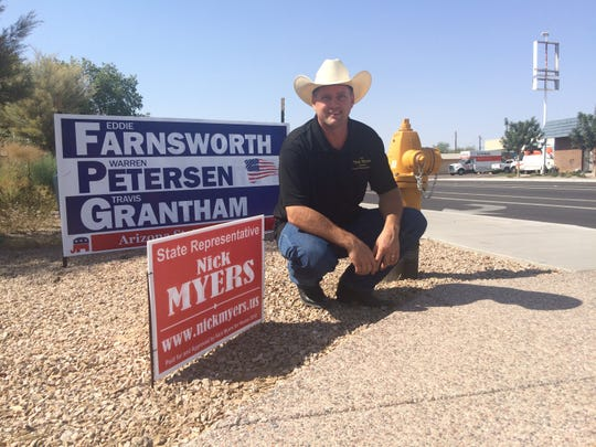 Nick Myers, a first time candidate for the Arizona Legislature, poses by one of his campaign signs on Aug. 7, 2018. Myers was facing candidates with more name recognition and, apparently, larger signs.