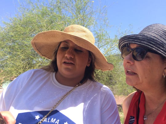 Alma Hernandez (left) and volunteer Sharon Glassberg look over a list of voter homes during a neighborhood canvass in downtown Tucson on Sunday, July 29.