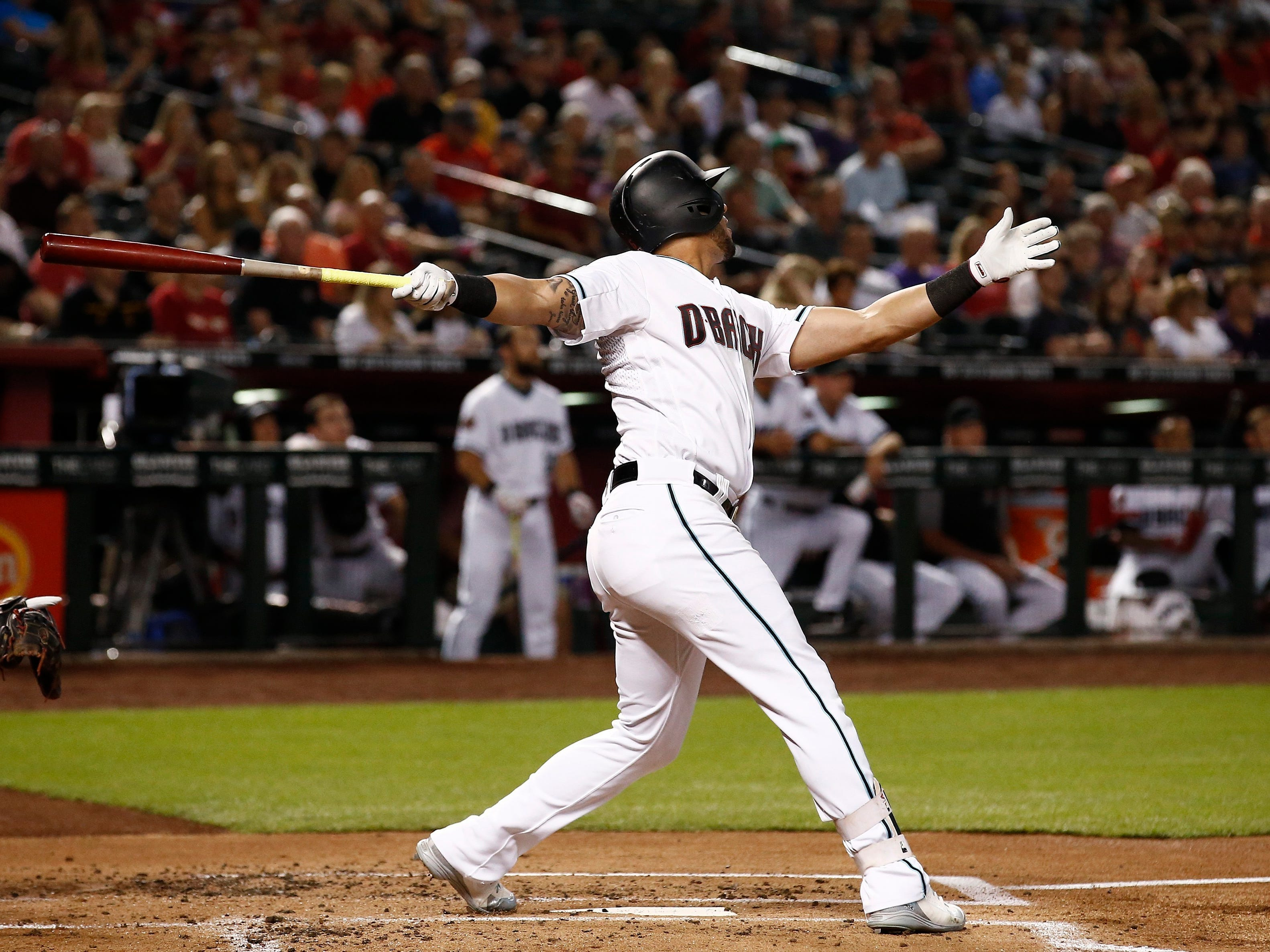 Arizona Diamondbacks' David Peralta watches the flight of his two-run home run against the Los Angeles Angels during the first inning of a baseball game Tuesday, Aug. 21, 2018, in Phoenix.