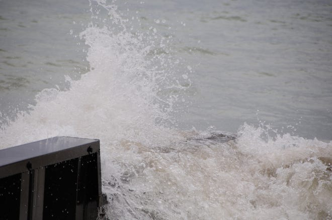 Big waves fueled by a north wind break on the Lake Huron shoreline. The National Weather Service has issued a lake flood advisory