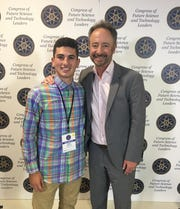 Our Lady of Lourdes student Daniel Gigliotti with Richard Rossi, founder and executive director of the National Academy of Future Scientists and Technologists, during the event in Cambridge, Massachusetts, earlier this summer.