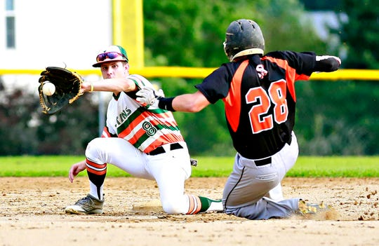 Jefferson's Derek Sheckard, left, looks to catch the ball as Stoverstown's Brandon Warner safely slides into second during Central League Baseball Championship Series, game 2 action in North Codorus Township, Wednesday, Aug. 22, 2018. Dawn J. Sagert