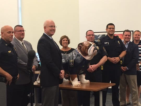West York Area School District Superintendent Todd Davies stands with members of the West Manchester township and police department after presenting a gift of a bulldog statue to honor the new school resource officers at the school board meeting Tuesday, Aug. 21.