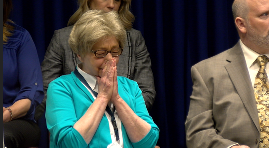 Juliann Bortz, a survivor of clergy abuse, reacts to the reading of the PA grand jury report.