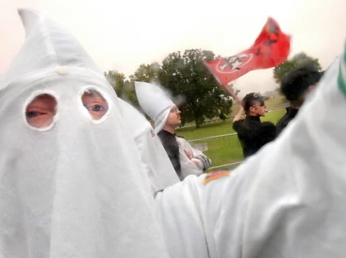 A man identifying himself only as Willie, the Grand Dragon for the West Virginia Chapter of the World Knights of the Ku Klux Klan, left, attends a rally in 2006 at Gettysburg National Military Park. He joined about 25 other Klansmen and supporters for the event. Klan representation at such rallies is often small.
