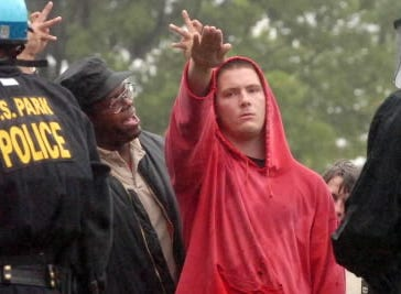 Daryle Lamont Jenkins, spokesman for the anti-racist One People's Project, yells at a KKK supporter during a rally the Klan held at Gettysburg National Military Park in 2006.